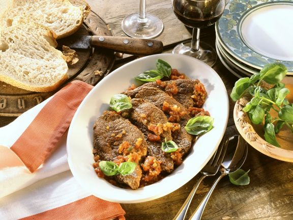 Steaks with Tomato Sauce and Basil