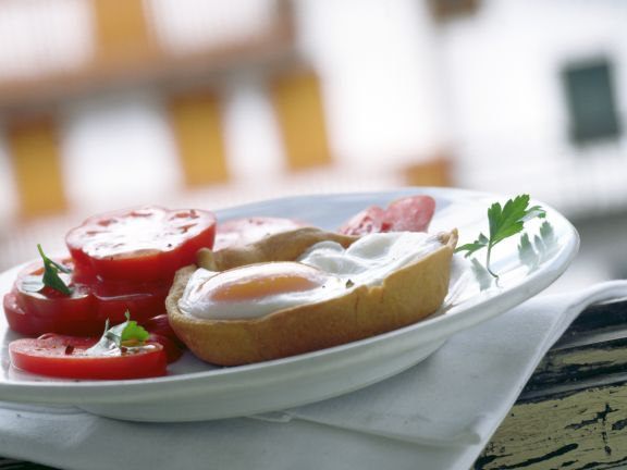 Two Cheese Tartlets with Fried Egg and Tomatoes