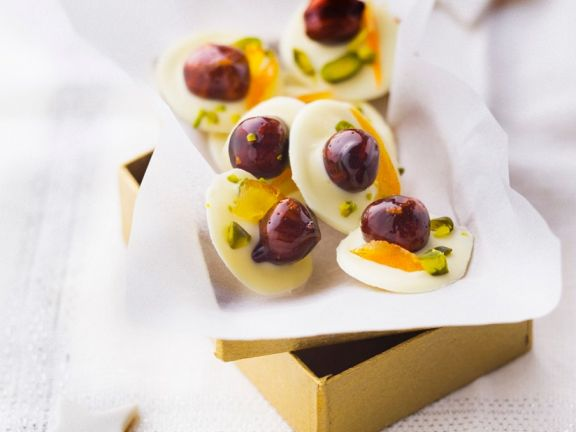 White Chocolate Medallions with Candied Hazelnuts, Orange and Pistachios