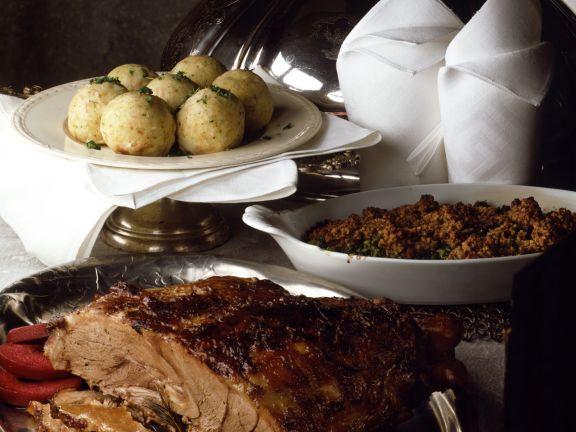 Wild Boar Roast with Elderberry Apples and Kale Gratin