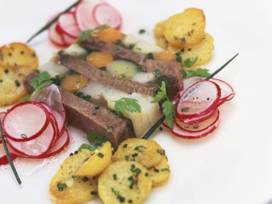 Beef aspic with radish salad and fried potatoes