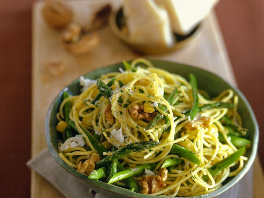 Bowl of green veg and nut pasta
