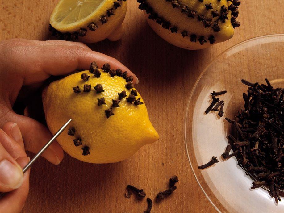 Lemon pomander ball with cloves