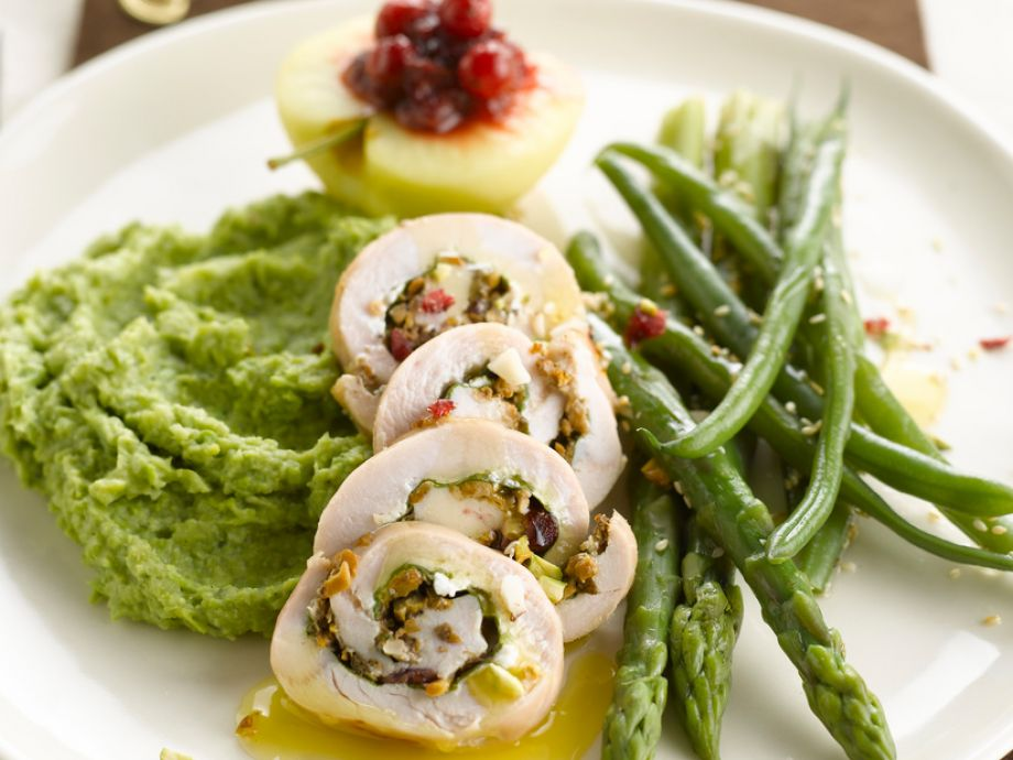 Turkey rolls with mashed potato peas and asparagus