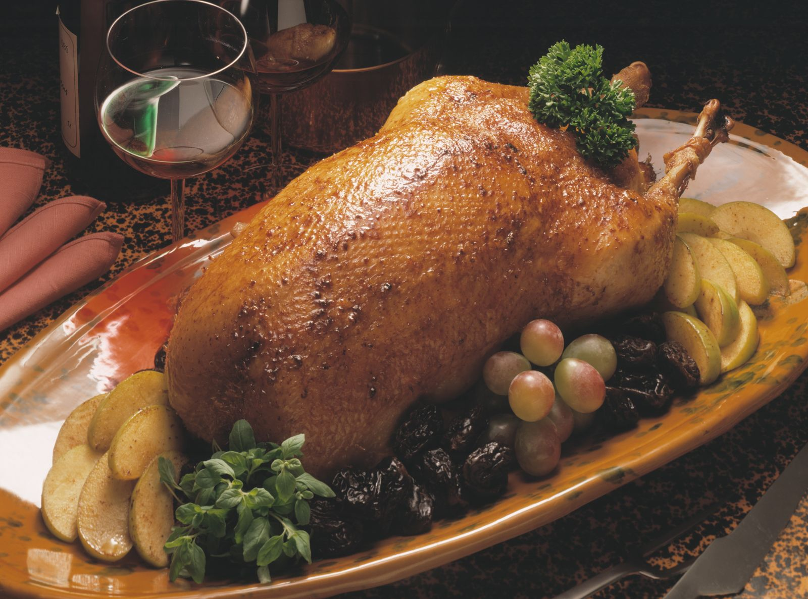 Stuffed Goose. Baked goose with apples and buckwheat in the oven 46