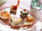 Canapes Five Ways: Smoked Salmon, Shrimp and White Asparagus, and Caviar and Quail Eggs, Cress and Cottage Cheese, Shrimp and Tomato recipe