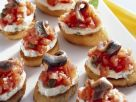 Crostini with Tomato, Cream Cheese and Anchovies recipe