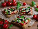 Pizza Toasts with Tomatoes, Olives and Mozzarella recipe